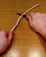 OneCup OneLife - Cutting the plastic around the wires with a knife 2.jpg